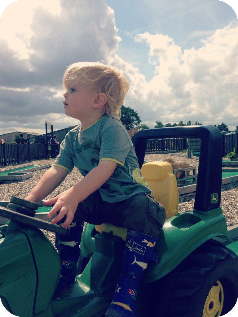 Little Man on tractor